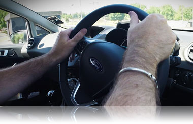 Holding the steering wheel properly